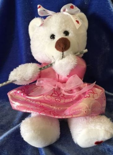 """White plush bear measures 8.5"""" in the seated position.  Bear is wearing a pink taffeta blouse, brocade skirt with pink glitter chiffon ribbon bow for accenting.  A white ribbon with red hears adds additional accenting.  This item has option of a flute or no flute.  Choose option or contact us directly if you have an issue. Thank you for viewing our cute bear!"""