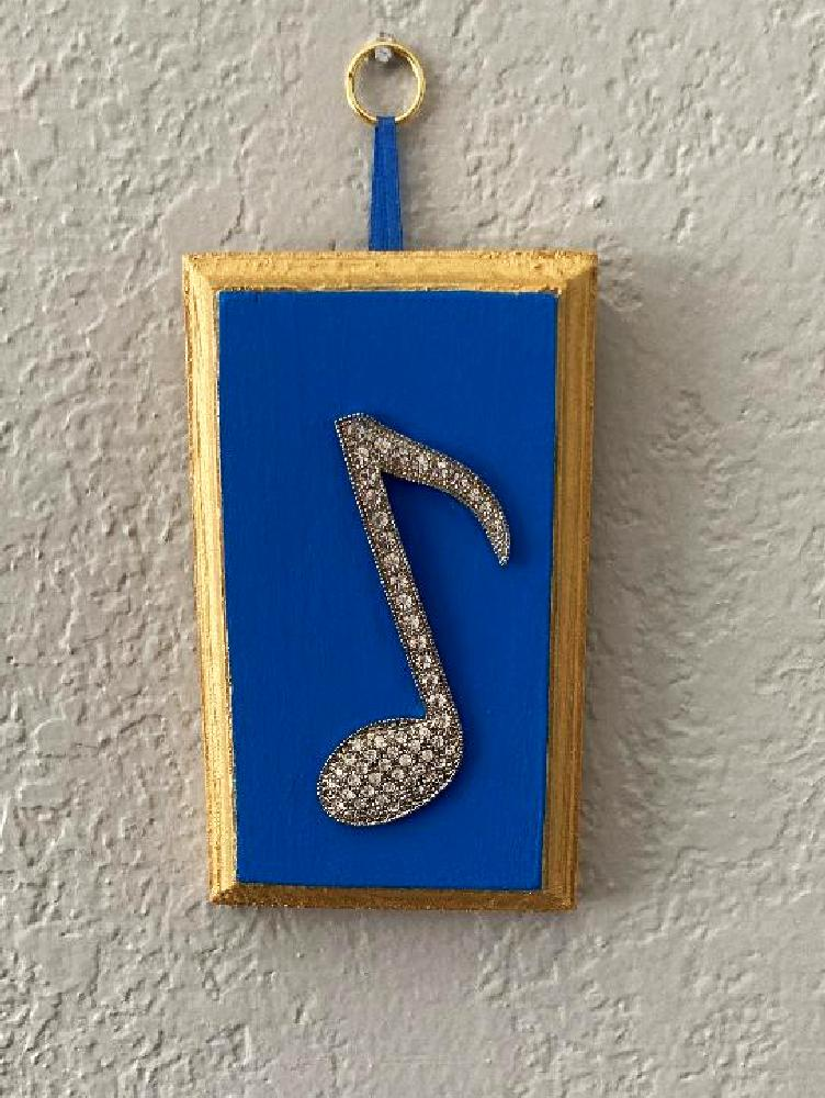 Basically the same plaques as the square version.  These are rectangler and have rhinestone nortes or treble clefs.  18K gold paint on sides and background are red or blues.  This is a limited edition of 2 in both colors.