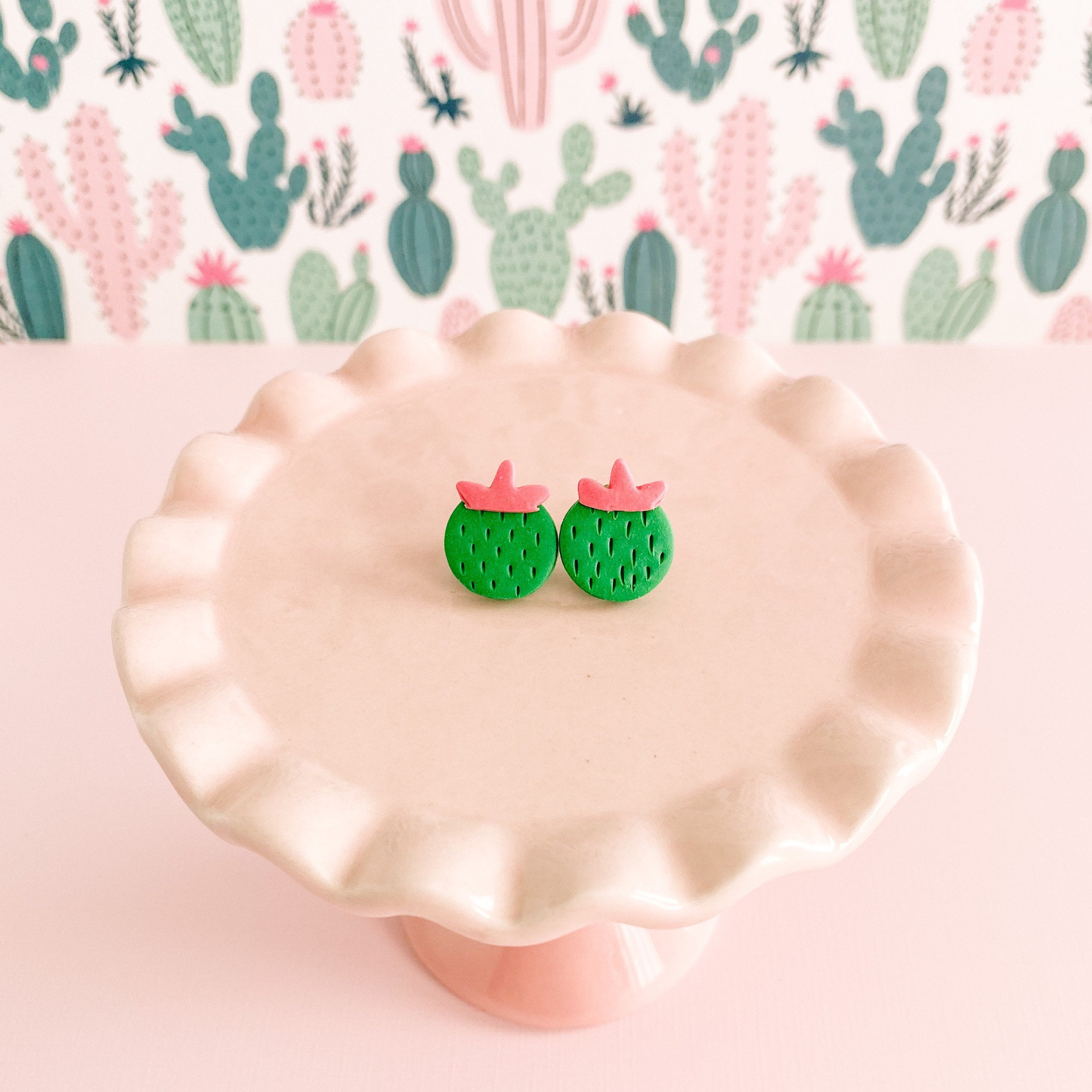 fireflyFrippery Cute Cactus Stud Earrings on Pink Display Stand