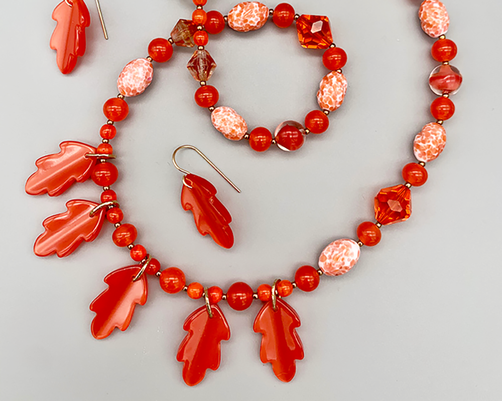 Necklace set | Mid-century vintage orange Lucite oak leaves, glass beads, and crystals