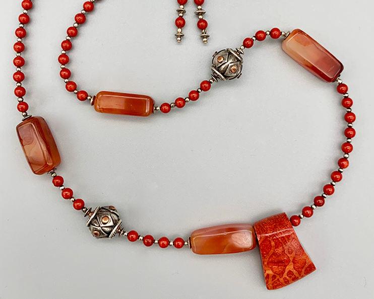 Necklace set | Sponge coral slider pendant over sterling silver and coral red rounds, Bali silver/copper, carnelian nuggets