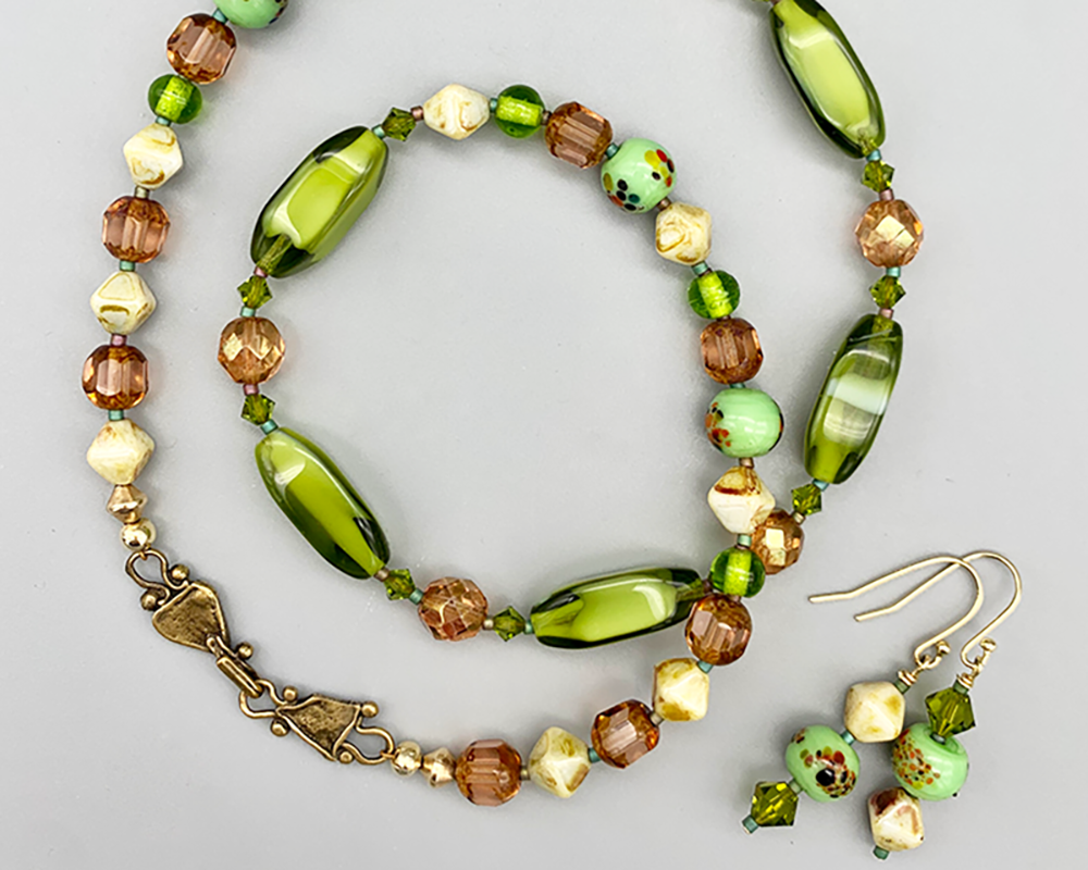 Necklace set   Vintage glass beads Japanese givre green planed ovals, amber faceted turbines and rounds, crystal accents