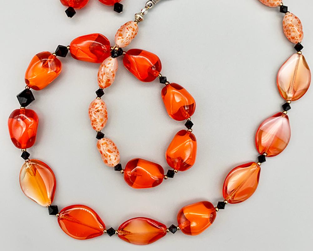 Necklace set | Orange/white givre nuggets, seed-shaped vintage glass beads, speckled irregular ovals, jet crystals
