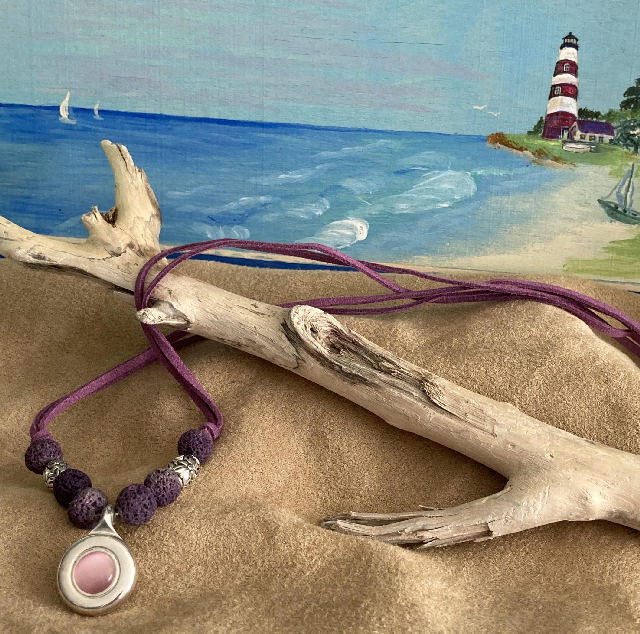 A necklace necklace from the  pinkceteyel, to the lava beads, to eyeing antique barrels, to the charming heart clasp. Purple seude is the cord for this beautiful jewelry design.