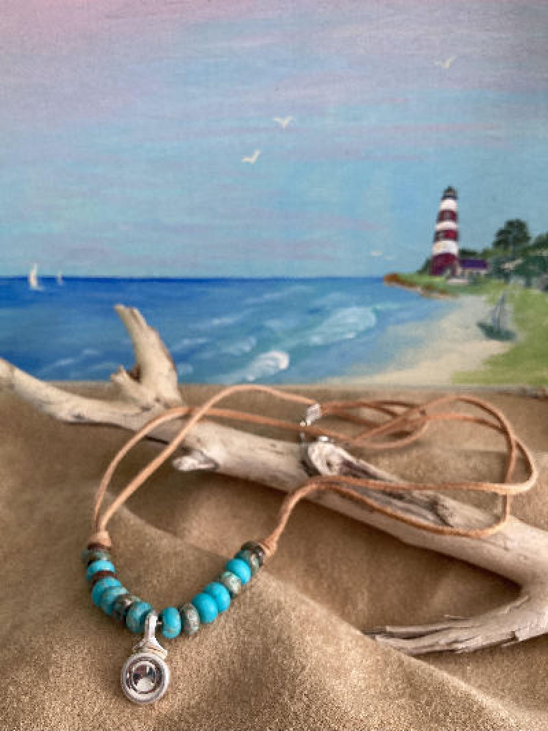 Gorgeous necklace designed in southwest motif.  Stunning silver flute key become a pendant. This beautifully designed necklace shows the real beauty of Turquoise  beads and suede cord from our Native Americans Ancestry.