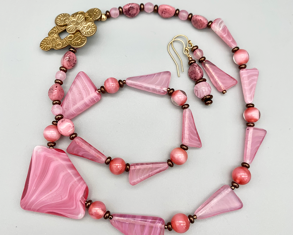Necklace set   1920s-30s Art Deco-inspired Czech translucent porphyry pink molded glass graduated strand, rose givre lampwork rounds